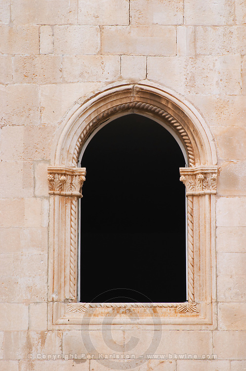 An arched window on an old building. Dubrovnik, old city. Dalmatian Coast, Croatia, Europe.