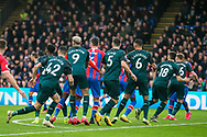 Scott Dann (Crystal Palace) in between six Newcastle United FC (The Magpies) players during a free kick during the Premier League match between Crystal Palace and Newcastle United at Selhurst Park, London, England on 22 February 2020.