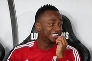 Saido Berahino of West Bromwich Albion looks on as he sits on the replacements bench ahead of kick off. Barclays Premier league match, Swansea city v West Bromwich Albion at the Liberty Stadium in Swansea, South Wales  on Boxing Day Saturday 26th December 2015.<br /> pic by  Andrew Orchard, Andrew Orchard sports photography.
