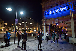 """© Licensed to London News Pictures. 27/02/2020. Bristol, UK. Bristol Light Festival; the artwork """"Overheard in Bristol"""" at Bristol Harbourside, a four-metro neon sign featuring the famous Bristolian phrase """"Cheers Drive"""". This is the launch of the first ever Bristol Light Festival, hosted by Bristol City Centre BID. Internationally renowned artists and local talent lighting up the city with a series of installations this weekend. Photo credit: Simon Chapman/LNP."""