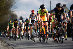 Peloton speed by with one lap to go - Grand Prix de Dottignies 2016. A 117km road race starting and finishing in Dottignies, Belgium on April 4th 2016.