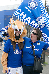 © Licensed to London News Pictures. 07/05/2016. Leicester, UK. Leicester City fans celebrating outside the King Power stadium before their match with Everton before lifting the Premiership trophy. Pictured, foxes everywhere. Photo credit: Dave Warren/LNP
