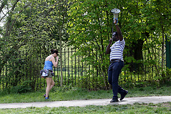 © Licensed to London News Pictures. 12/04/2020. London, UK. A staff member of Haringey Council with a megaphone asking people to leave the park if they aren't exercising in Finsbury Park, north London during coronavirus lockdown. Over 10,000 people in the UK have died in hospitals due to COVID-19. Photo credit: Dinendra Haria/LNP