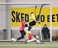 Fotball<br /> 20 februar 2010<br /> Treningskamp<br /> Lillestrøm - Fredrikstad<br /> Antony Ujah , Lillestrøm scorer mens Amin Askar , Fredrikstad ligger nede<br /> Foto : Reidar Talset , Digitalsport