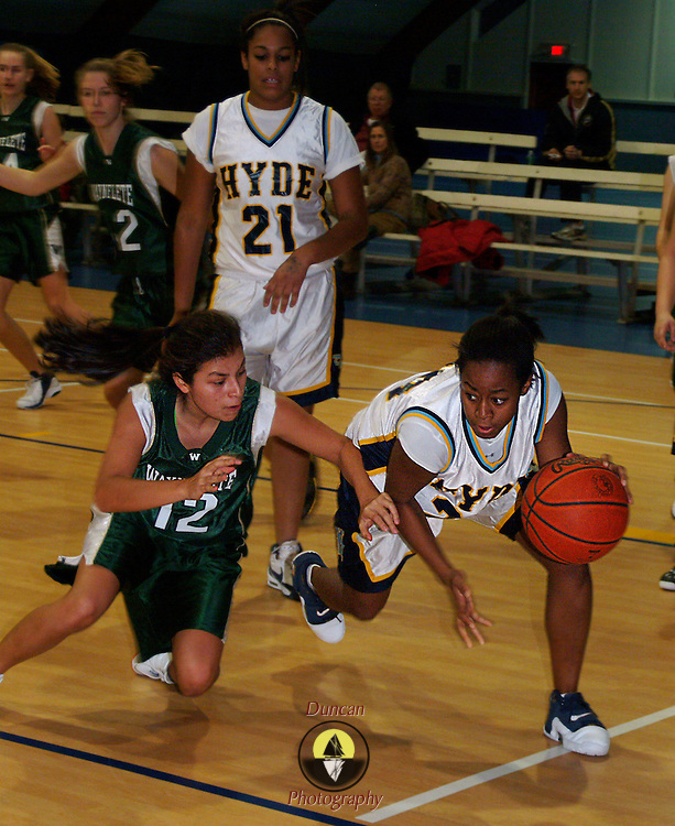 January 22, 2008 -- HYDE SCHOOL, BATH, Maine.   Hyde's Keionna Besley evades the outstretched arm of Waynflete Guard Nina Russem in the fourth quarter. Despite taking out many of the starters, Waynflete ran up the score on the Hyde girls on Tuesday night in Bath: final :53-22.  Photo by Roger S. Duncan.