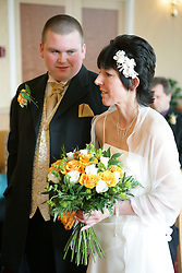 Bride and groom taking marriage vows at a registry office wedding,