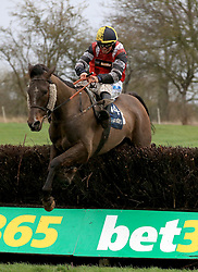 Potters Corner ridden by James Bowen clears the last hurdle and wins the Marstons 61 Deep Midlands Grand National race at Uttoxeter Racecourse.