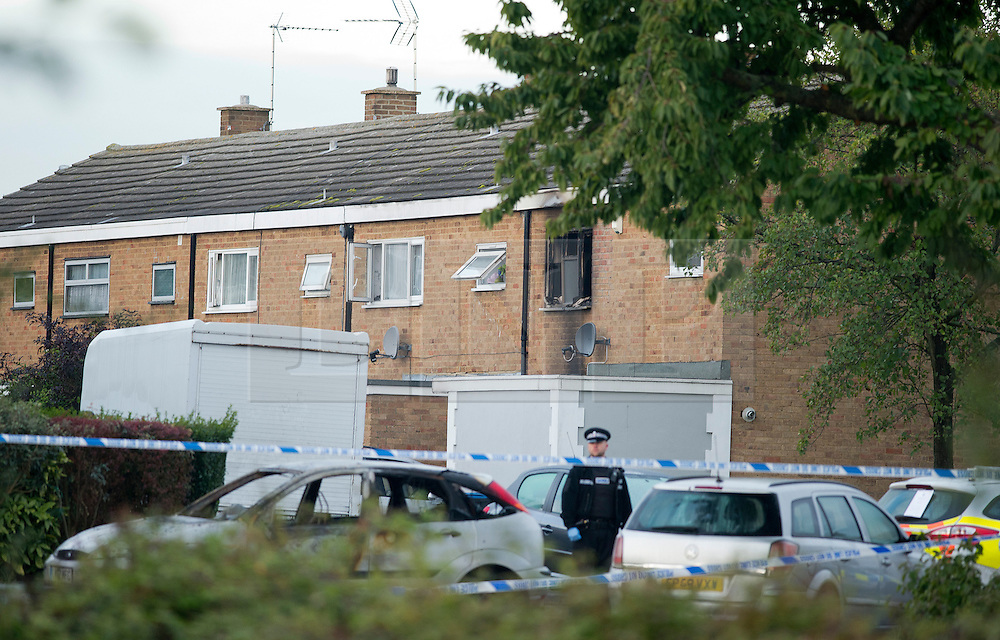 ©  London News Pictures. 15/10/2012. Harlow, UK. A house (pictured rear) on Barn Mead, Harlow, Essex where three children and a woman have died and three others are in hospital following a house fire. Two boys aged 13 and six, a girl aged 11 and the woman were declared dead at the scene. A nine-year-old boy and a three-year-old girl have serious burns and a man has minor burns. Photo credit : Ben Cawthra/LNP