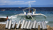 Diving excusion boat moored along the coast of the Philippines, Southeast Asia