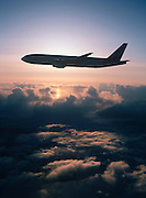 Boeing Airliner in flight at sunset