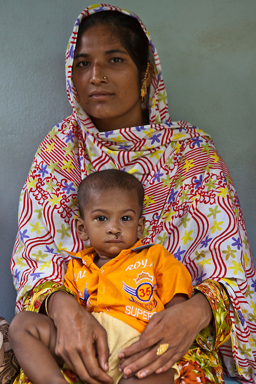 Charnatul and her 1 year old son, Mohamed, wait for a check up after cleft palate surgery at the IFB Chuandanga Hospital in the western region of Bangladesh..Impact Foundation Bangladesh (IFB) provide care, support and treatment to people with disabilities in Bangladesh.