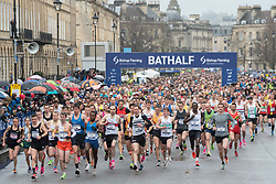 © Licensed to London News Pictures; 15/03/2020; Bath, UK. The Bath Half Marathon takes place during the coronavirus crisis. There have been calls to cancel or postpone the event after many other sporting and other events have been cancelled or postponed as cases of infection and deaths due to the virus increase across the UK, and the Government plans to bring in legislation to ban all large public gatherings perhaps as early as next weekend. Organisers of the half marathon say they have taken advice that the risk is low and say that it is too late to cancel the event. Photo credit: Simon Chapman/LNP.