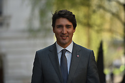 April 18, 2018 - London, England, United Kingdom - Canadian Prime Minister Justin Trudeau smiles as he arrives Downing Street to meeting British Prime Minister Theresa May for talks on April 18, 2018 in London, England. Mrs May holds bilateral talks with a number of Commonwealth leaders today as the UK this week hosts heads of state and government from the Commonwealth nations. (Credit Image: © Alberto Pezzali/NurPhoto via ZUMA Press)