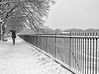 The running track at the Reservoir in Central Park during a snow storm.