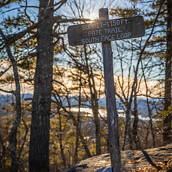 Summit sign at Loon Echo Land Trust's Bald Pate Mountain Preserve in South Bridgton, Maine.