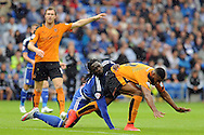 Cardiff City's Kenwyne Jones (c) collides with Wolves' Ethan Ebanks-Landell (r). Skybet football league championship match, Cardiff city v Wolverhampton Wanderers at the Cardiff city stadium in Cardiff, South Wales on Saturday 22nd August 2015.<br /> pic by Carl Robertson, Andrew Orchard sports photography.