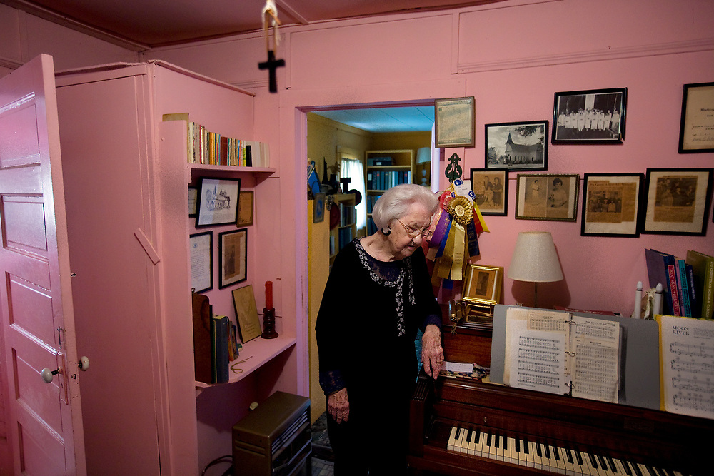 """In a moment of confusion Carrie LeNoir rest in her 'piano room' where her many awards adorn the walls. She had a hand in all sorts of civic affairs: the Sumter County Democratic Party, the Poinsett Garden Club, volunteer firefighter. """"She is the epitome of a Southern lady,"""" said family friend, Mackenzie Sholtz. """"She could run a tractor, run a post office, do a tea party."""""""