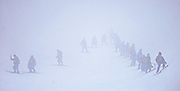 Slippers prepare the halfpipe in snow and fog for the finals of the men's ski halfpipe at Rosa Khutor Extreme Park during the Winter Olympics in Sochi, Russia, Tuesday, Feb. 18, 2014. (Brian Cassella/Chicago Tribune/MCT)