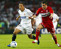 Photo: Chris Ratcliffe.<br /> Middlesbrough v Sevilla. UEFA Cup Final. 10/05/2006.<br /> Middlesbrough's Stuart Parnaby tussles with Sevilla's Luis Fabiano.