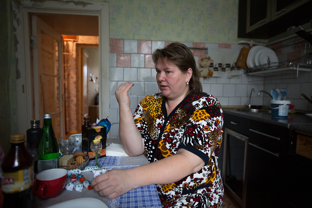 CAPTION: Sitting in her kitchen, Lybov talks about her experiences and the challenges she's faced while bringing up a child with multiple severe disabled. She started using the Short Break Service provided by Partnership for Every Child (P4EC) in 2007, and nowadays takes advantage of it for five hours every five days to go to the hospital to explore treatments for her son, and also to go to church. NAME MUST BE CHANGED. LOCATION: St Petersburg, Russia. INDIVIDUAL(S) PHOTOGRAPHED: Lybov Chusheva NAME MUST BE CHANGED.
