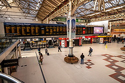 © Licensed to London News Pictures. 16/03/2020. London 8.42am, UK. Normally packed with commuters a very quiet Victoria Station this morning as Government ministers warn that over 70s will face set-isolation for weeks as the Coronavirus disease pandemic continues . Photo credit: Alex Lentati/LNP
