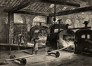 A battery of rolling mills producing steel rail.  Illustration  by the British artist William Heysman Overend (1851-1898).   Engraving from 'Great Industries of Great Britain' (London, c1880).  Engraving.