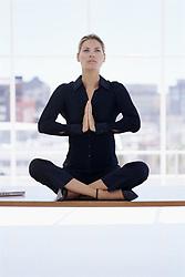 Dec. 05, 2012 - Woman meditating on her desk (Credit Image: © Image Source/ZUMAPRESS.com)