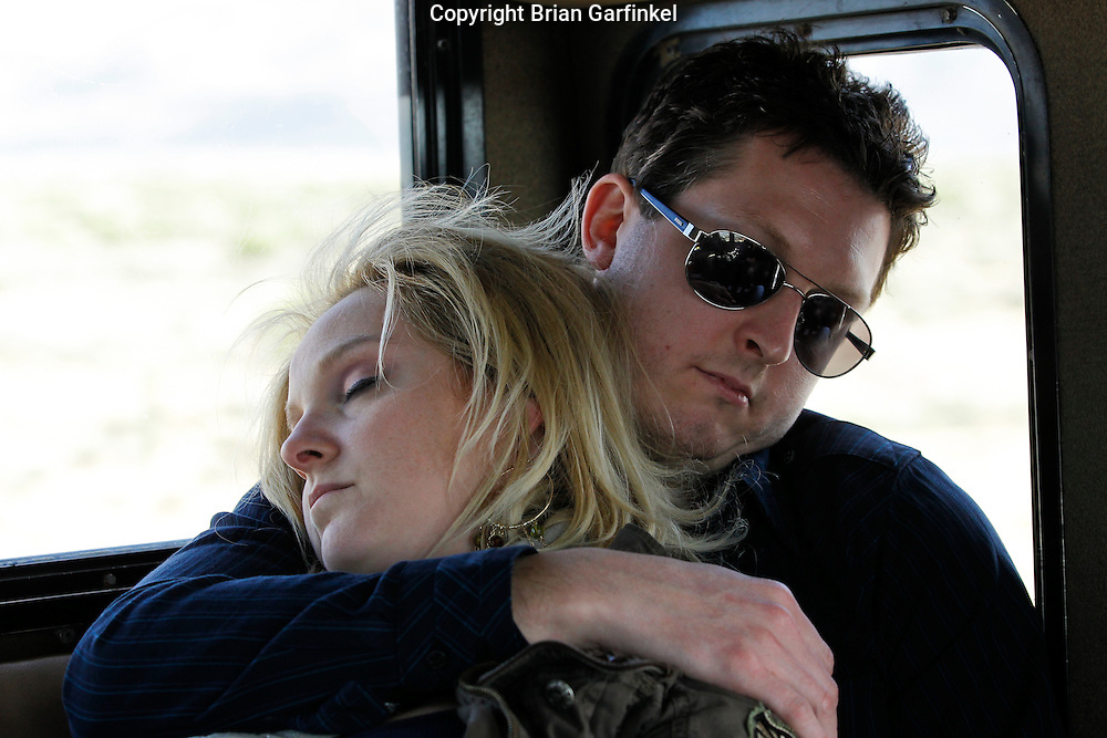 Brooke and Wes sleep on the way back from The Grand Canyon in Arizona on March 26th 2011. (Photo By Brian Garfinkel)