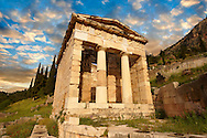 The reconstructed Treasury of Athens, built to commemorate their victory at the Battle of Marathon. Delphi, archaeological site, Greece, .<br /> <br /> If you prefer to buy from our ALAMY PHOTO LIBRARY  Collection visit : https://www.alamy.com/portfolio/paul-williams-funkystock/delphi-site-greece.html  to refine search type subject etc into the LOWER SEARCH WITHIN GALLERY.<br /> <br /> Visit our ANCIENT GREEKS PHOTO COLLECTIONS for more photos to download or buy as wall art prints https://funkystock.photoshelter.com/gallery-collection/Ancient-Greeks-Art-Artefacts-Antiquities-Historic-Sites/C00004CnMmq_Xllw