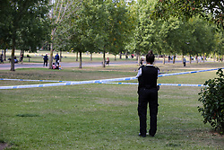 © Licensed to London News Pictures. 21/07/2020. London, UK. Police officers guard the crime scene in Finsbury Park, north London, following triple stabbings. Police officers were called at 2.51pm to reports of stabbings and assault in Finsbury Park, north London. It has been reported that a group of men, who were intoxicated were involved in a fight. One man has been arrested. Photo credit: Dinendra Haria/LNP