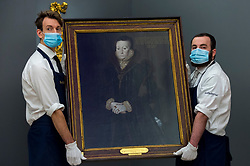 """© Licensed to London News Pictures. 07/12/2020. LONDON, UK. Technicians present """"Portrait of Joan Thornbury, Mrs Richard Wakeman"""", by Hans Eworth (Est. £400k-600k). Preview of Sotheby's upcoming Christmas Sale Series of Old Masters and Treasures - paintings and objects spanning 800 Years.  The sales will be at Sotheby's New Bond Street gallery.  Photo credit: Stephen Chung/LNP"""