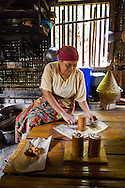 Traditional Javanese process for making brown sugar in a rural village in West Java, Indonesia. The thickened mixture is poured into tubes to harden. The finished product is wrapped and sold in a market in a nearby town (6 hour walk).