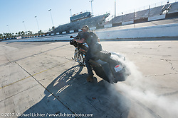 Moonshiner Josh Owens having fun on the track on his Harley-Davidson after Billy Lane's Son's of Speed race during Daytona Bike Week. New Smyrna Beach, FL. USA. Saturday March 18, 2017. Photography ©2017 Michael Lichter.