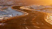 A winding road in the golden hour light before sunset, Westfjords