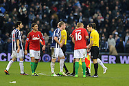 Swansea city capt Garry Monk (16) and Angel Rangel (22) have words with referee Lee Mason and his assistants at the end of the match after the officials had disallowed a 'goal' scored by Swansea player Roland Lamah. Barclays Premier league, West Bromwich Albion v Swansea city at the Hawthorns stadium in West Bromwich, England on Saturday 9th March 2013.  pic by  Andrew Orchard, Andrew Orchard sports photography,