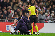 Stephanie Frappart, Referee  stands along side the team giving treatment to Beth Mead (England) injured following a tackle with Sara Doorsoun-Khajeh (Germany) during the International Friendly match between England Women and Germany Women at Wembley Stadium, London, England on 9 November 2019.