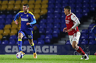 AFC Wimbledon attacker Adam Roscrow (10) dribbling and taking on Arsenal defender William Saliba (4) during the EFL Trophy match between AFC Wimbledon and U21 Arsenal at Plough Lane, London, United Kingdom on 8 December 2020.
