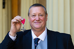 ROTA:  London Lifeboat Station helmsman Stanley Todd proudly display his MBE awarded for services to maritime safety at an investiture at Buckingham Palace in London. London, November 13 2018.