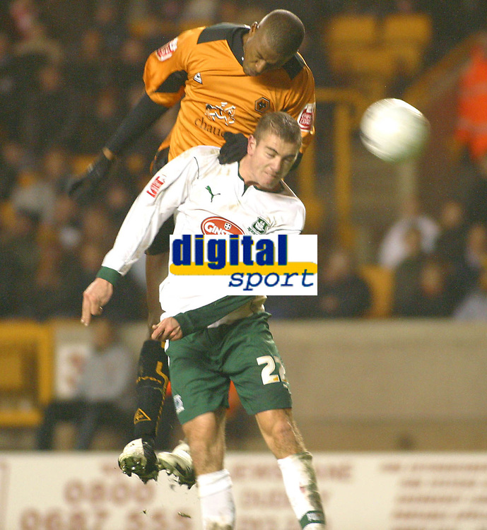 Photo: Dave Linney.<br />Wolverhampton Wanderers v Plymouth Argyle. The FA Cup.Woles's Carl Cort(Top) rises above    Paul Connolly<br />07/01/2006.