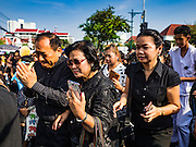 16 DECEMBER 2015 - BANGKOK, THAILAND:  Thais walk in the funeral procession for Somdet Phra Nyanasamvara, who headed Thailand's order of Buddhist monks for more than two decades and was known as the Supreme Patriarch. He died Oct. 24, 2013, at a hospital in Bangkok and was cremated today. He was 100. He was ordained as a Buddhist monk in 1933 and appointed as the Supreme Patriarch in 1989. He was the spiritual advisor to Bhumibol Adulyadej, the King of Thailand when the King served as a monk in 1956. Tens of thousands of people lined the streets during the procession to pray for the Patriarch.    PHOTO BY JACK KURTZ