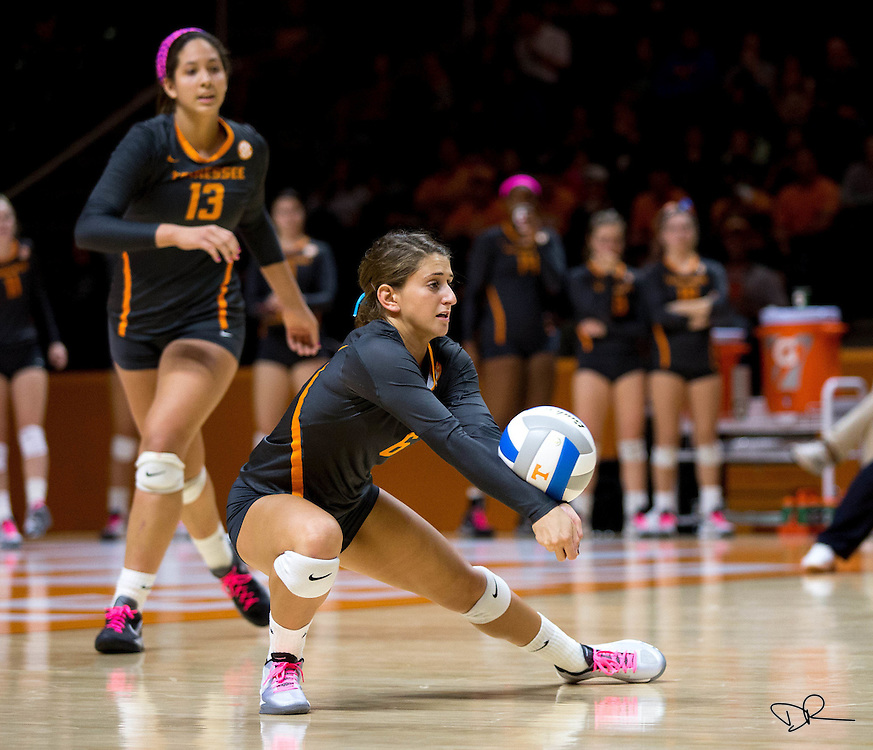 A University of Tennessee volleyball player bumps the ball during a match against the University of Alabama at the Thompson–Boling Arena.