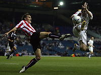 Photo: Paul Thomas.<br /> Leeds United v Sunderland. Coca Cola Championship. 13/09/2006.<br /> <br /> Sunderland's Dean Whitehead tries to tackle Jonathan Douglas.