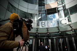 © Licensed to London News Pictures. 25/02/2016. London, UK. A television camera pointed at the front entrance to BBC Broadcasting House in London where a report in to abuse by DJ Jimmy Savile has been released. The Dame Janet Smith review found that the BBC repeatedly failed to stop abuse by DJ Jimmy Savile and broadcaster Stuart Hall. Photo credit: Ben Cawthra/LNP