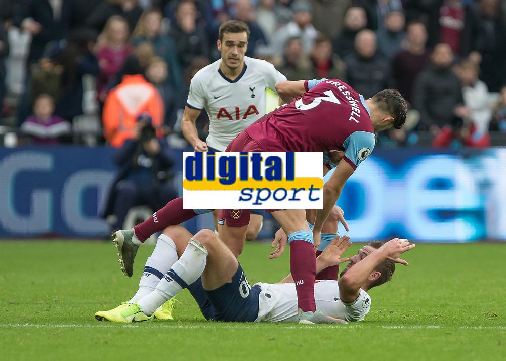 Football - 2019 / 2020 Premier League - West Ham United vs. Tottenham Hotspur<br /> <br /> Aaron Cresswell (West Ham United) and Robert Snodgrass (West Ham United) stand over Harry Kane (Tottenham FC)  accusingly after he goes down at the London Stadium<br /> <br /> COLORSPORT/DANIEL BEARHAM