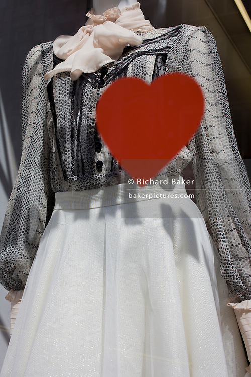 The shape of a red heart seen against a mannequin's dress in New Bond Street, central London.