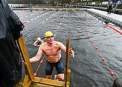 © Licenced to London News Pictures. 06/02/2016. Windermere, Cumbria, UK. Endurance swimming event in Windermere during Winter months. Swimmers swim various distances from 30 metres to 1 kilometre during the event in Low Wood Bay, Windermere. Water temperature is around 6.4 degrees centigrade. International athletes and amateur swimmers come to take part. Photo credit : Harry Atkinson/LNP