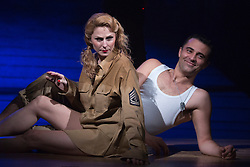 """© Licensed to London News Pictures. 16/10/2013. London, England. Pictured: Rebecca Thornhill and Darius Campbell relaxing during the photocall. The Musical """"From Here to Eternity"""" opens at the Shaftesbury Theatre on 23 October 2013 starring Darius Campbell, Siubhan Harrison, Robert Lonsdale and Rebecca Thornhill. This brand new musical is directed by Tamara Harvey and lyrics by Tim Rice, music by Stuart Brayson and script by Bill Oakes. Photo credit: Bettina Strenske/LNP"""