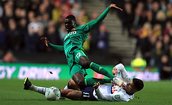 """Watford's Ken Sema (left) and Tottenham Hotspur's Erik Lamela battle for the ball during the Carabao Cup, Third Round match at Stadium MK, Milton Keynes. PRESS ASSOCIATION Photo. Picture date: Wednesday September 26, 2018. See PA story SOCCER Tottenham. Photo credit should read: Mike Egerton/PA Wire. RESTRICTIONS: EDITORIAL USE ONLY No use with unauthorised audio, video, data, fixture lists, club/league logos or """"live"""" services. Online in-match use limited to 120 images, no video emulation. No use in betting, games or single club/league/player publications."""