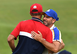 Team Europe's Sergio Garcia (right) hugs Team USA's Bryson Dechambeau on the 16th green during day three of the 43rd Ryder Cup at Whistling Straits, Wisconsin. Picture date: Sunday September 26, 2021.