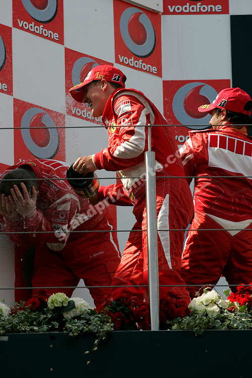 Michael Schumacher and Felipe Massa spry champagne on Ferari technical director Ross Brawn on the podium after the 2006 European Grand Prix at the Nurbrugring. Photo: Grand Prix Photo